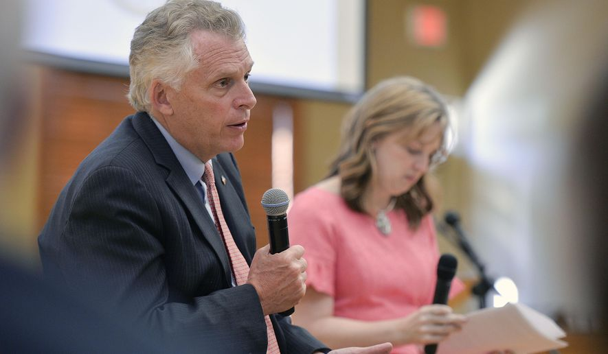 Virginia Gov. Terry McAuliffe and Dr. Sarah Melton take questions on the opioid epidemic during a town hall meeting Monday, May 8, 2017, evening at the Abingdon Community Center in Abingdon, Va. (Andre Teague/The Bristol Herald-Courier via AP)