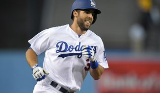 Los Angeles Dodgers' Chris Taylor smiles as he rounds third after hitting a grand slam during the first inning of a baseball game against the Pittsburgh Pirates, Monday, May 8, 2017, in Los Angeles. (AP Photo/Mark J. Terrill)