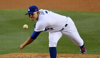 Los Angeles Dodgers starting pitcher Julio Urias throws during the second inning of the team's baseball game against the Pittsburgh Pirates, Tuesday, May 9, 2017, in Los Angeles. (AP Photo/Mark J. Terrill)