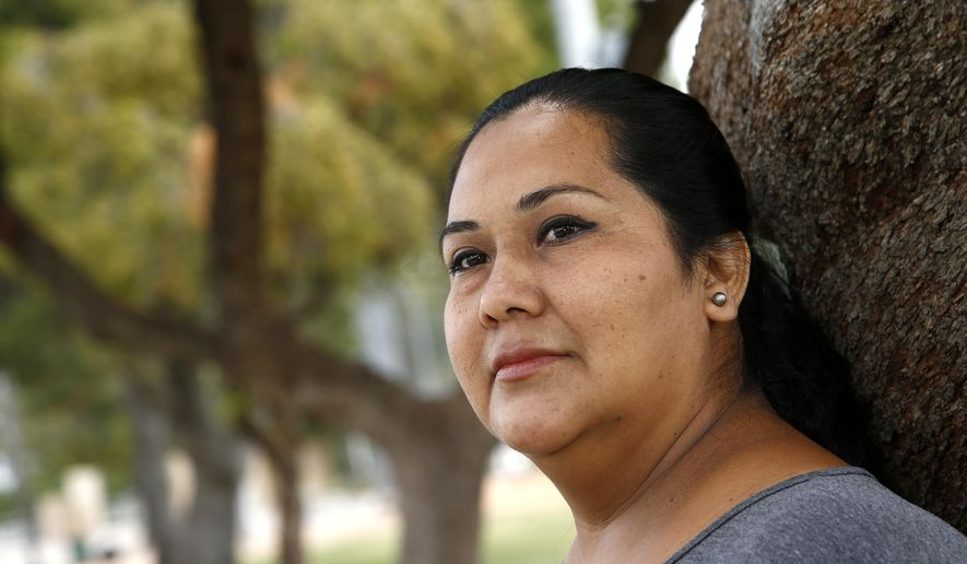 Blanca Chico, an uninsured patient, uses Planned Parenthood Arizona to get her health services pauses in a nearby park near to where she lives on Tuesday, May 9, 2017, in Scottsdale, Ariz.  Republican lawmakers in Arizona and Iowa took steps to join a growing list of states that have acted to curtail public funding for Planned Parenthood, which is the leading provider of abortions in the U.S. but also provides a range of other health services that would be affected by the funding cuts.  (AP Photo/Ross D. Franklin)