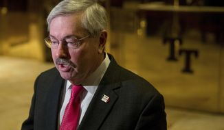 FILE - In this Dec. 6, 2016 file photo, Iowa Gov. Terry Branstad speaks to members of the media in the lobby of Trump Tower in New York. A Senate panel has approved Branstad as U.S. ambassador to China. (AP Photo/Andrew Harnik, File)
