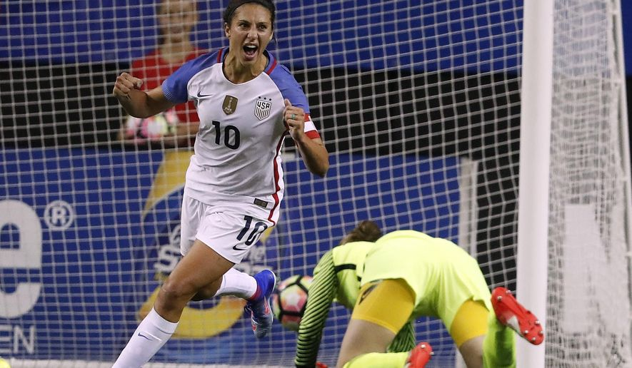 FILE - In this Sunday, Sept. 18, 2016 file photo, USA's Carli Lloyd celebrates after beating Netherlands goalkeeper Sari van Veenendaal during an exhibition soccer match, in Atlanta. Manchester City has allowed FIFA Player of the Year Carli Lloyd to miss a domestic league match in England, breaking off from preparations for the FA Cup final, to fly to the Middle East to promote world soccer's governing body. Lloyd skipped the game on Tuesday, May 9, 2017 at Bristol City to fly around seven hours to the Gulf, with City granting permission because the game was rescheduled due to the club's Champions League progress. (AP Photo/John Bazemore, file)