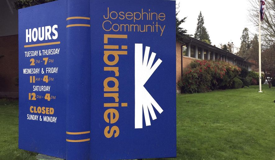 In this April 7, 2017, photo, a large display stands in the lawn of the main Josephine County library branch in Grants Pass, Ore. The library system in Josephine County has been operating as a nonprofit on donations and volunteer hours since it lost public funding, but a measure on the May 16 ballot could restore limited tax dollars by creating a special library tax district. (AP Photo/Gillian Flaccus)