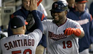 Minnesota Twins' Kennys Vargas (19) celebrates his two-run home run with Twins starter Hector Santiago during the fourth inning of the team's baseball game against the Chicago White Sox on Tuesday, May 9, 2017, in Chicago. (AP Photo/Charles Rex Arbogast)