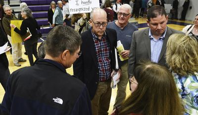 In a Monday, May 8, 2017 photo, U.S. Rep. Greg Walden, R-Ore., talks with attendees after a town hall meeting in Baker City, Ore. Walden defended his vote to repeal and replace major parts of the Affordable Care Act, telling constituents at a series of town hall meetings that he saw last week's action as a way to fix a failing system.   (E.J. Harris/East Oregonian via AP)