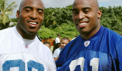 Former Tampa Bay Buckaneers DB Ronde Barber, left, and his brother Former New York Giants RB Tiki Barber.