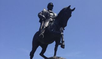 A statue of Confederate Gen. P.G.T. Beauregard at the entrance to New Orleans City Park. A last-ditch effort to block the removal of a monument to a Confederate general in New Orleans was rejected Wednesday, May 10, 2017, by a Louisiana judge who turned away arguments that the city doesn't own the statue or the land on which it sits. (AP Photo/Kevin McGill)