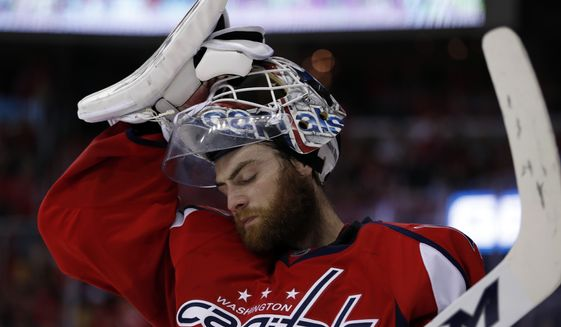 Washington Capitals goalie Braden Holtby (70) pauses during the first period of Game 7 in an NHL Stanley Cup Eastern Conference semifinal hockey game against the Pittsburgh Penguins, Wednesday, May 10, 2017, in Washington. (AP Photo/Alex Brandon)