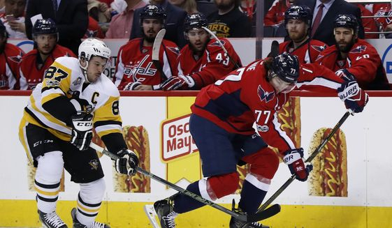 Washington Capitals right wing T.J. Oshie (77) tries to get away from Pittsburgh Penguins center Sidney Crosby (87) during the first period of Game 7 in an NHL hockey Stanley Cup Eastern Conference semifinal, Wednesday, May 10, 2017, in Washington. (AP Photo/Alex Brandon) **FILE**