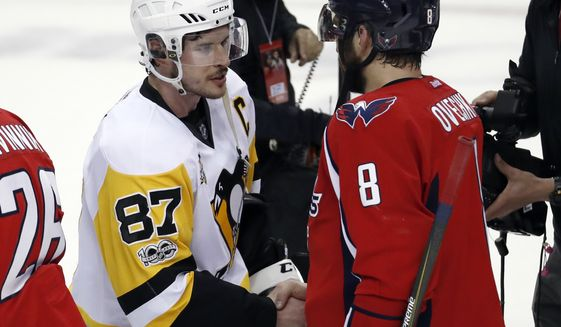 Washington Capitals left wing Alex Ovechkin (8), from Russia, talks with Pittsburgh Penguins center Sidney Crosby (87) after Game 7 in an NHL hockey Stanley Cup Eastern Conference semifinal, Wednesday, May 10, 2017, in Washington. The Penguins won 2-0. (AP Photo/Alex Brandon)