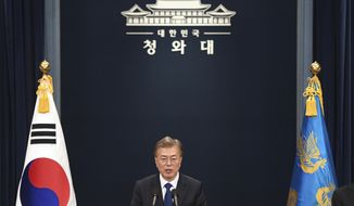 FILE - In this May 10, 2017, file photo, South Korea's new President Moon Jae-In speaks at the presidential Blue House in Seoul. Addressing the nation after taking the oath of office on Wednesday, May 10, 2017, South Korean President Moon Jae-in vowed to eventually move out of the Blue House, where every modern South Korean president has lived and worked since the end of World War II. (JungJ Yeon-Je/Pool Photo via AP)