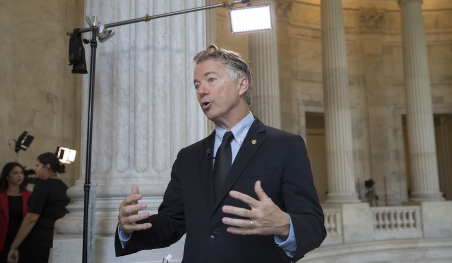 Sen. Rand Paul, R-Ky., a member of the Senate Foreign Relations Committee, reacts to the firing of FBI Director James Comey by President Donald Trump during a television interview on Capitol Hill in Washington, early Wednesday, May 10, 2017.  (AP Photo/J. Scott Applewhite)