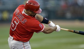 Los Angeles Angels' Albert Pujols swings for a home run off Oakland Athletics' Jharel Cotton in the first inning of a baseball game, Tuesday, May 9, 2017, in Oakland, Calif. (AP Photo/Ben Margot)