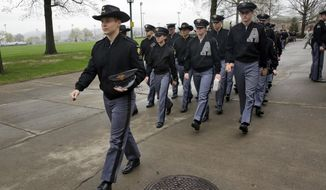 In this Friday, April 21, 2017, photo, Cadet Sumner Ogrydziak (left) leads fellow members of F-Troop to lunch at the U.S. Military Academy at West Point, N.Y. (Associated Press) **FILE**