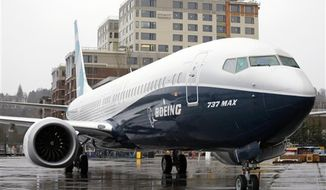 FILE - In this March 7, 2017, file photo, the first of the large Boeing 737 MAX 9 models, Boeing's newest commercial airplane, sits outside its production plant in Renton, Wash. Boeing stops test flights of its new 737 model because of a possible problem in engine discs. The company is working with engine maker CFM to investigate. The company said Wednesday, May 10, 2017, it was notified of a potential manufacturing-quality issue by CFM, which makes the engines that are going on the Boeing 737 Max. (AP Photo/Elaine Thompson, File)
