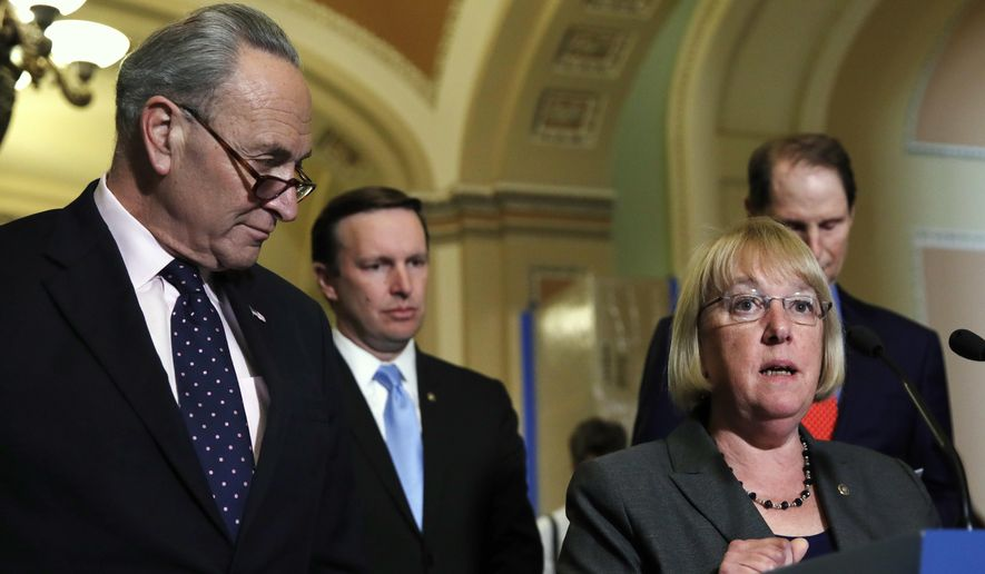Sen. Patty Murray of Washington, accompanied by Senate Minority Leader Charles E. Schumer of New York (left), Sen. Christopher Murphy of Connecticut (second from left) and Sen. Ron Wyden of Oregon addressed the media after a Democratic policy luncheon on Wednesday. (Associated Press)