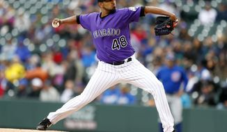 Colorado Rockies starting pitcher German Marquez throws to the plate during the first inning of a baseball game against the Chicago Cubs, Wednesday, May 10, 2017, in Denver. (AP Photo/Jack Dempsey)