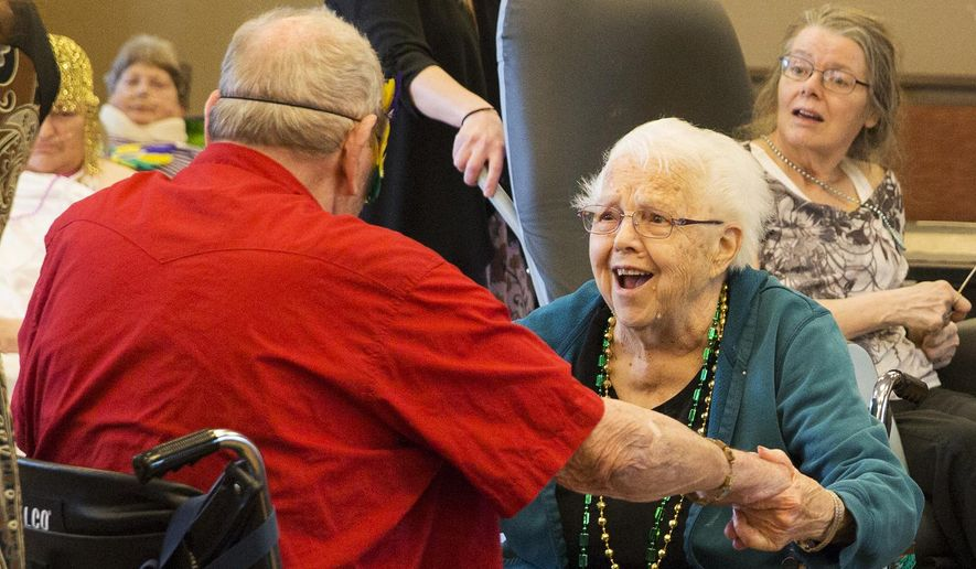 In this April 25, 2017, photo, Betty Henson enjoys a dance with Gordon Patterson during the masquerade ball at the Legacy Living and Rehabilitation Center in Gillette, Wy. This years theme for the prom was a masquerade ball and the residents would get twirled around on the dance floor while listening to live music and after enjoy snacks and refreshments. (Kelly Wenzel/Gillette News Record via AP) ** FILE **