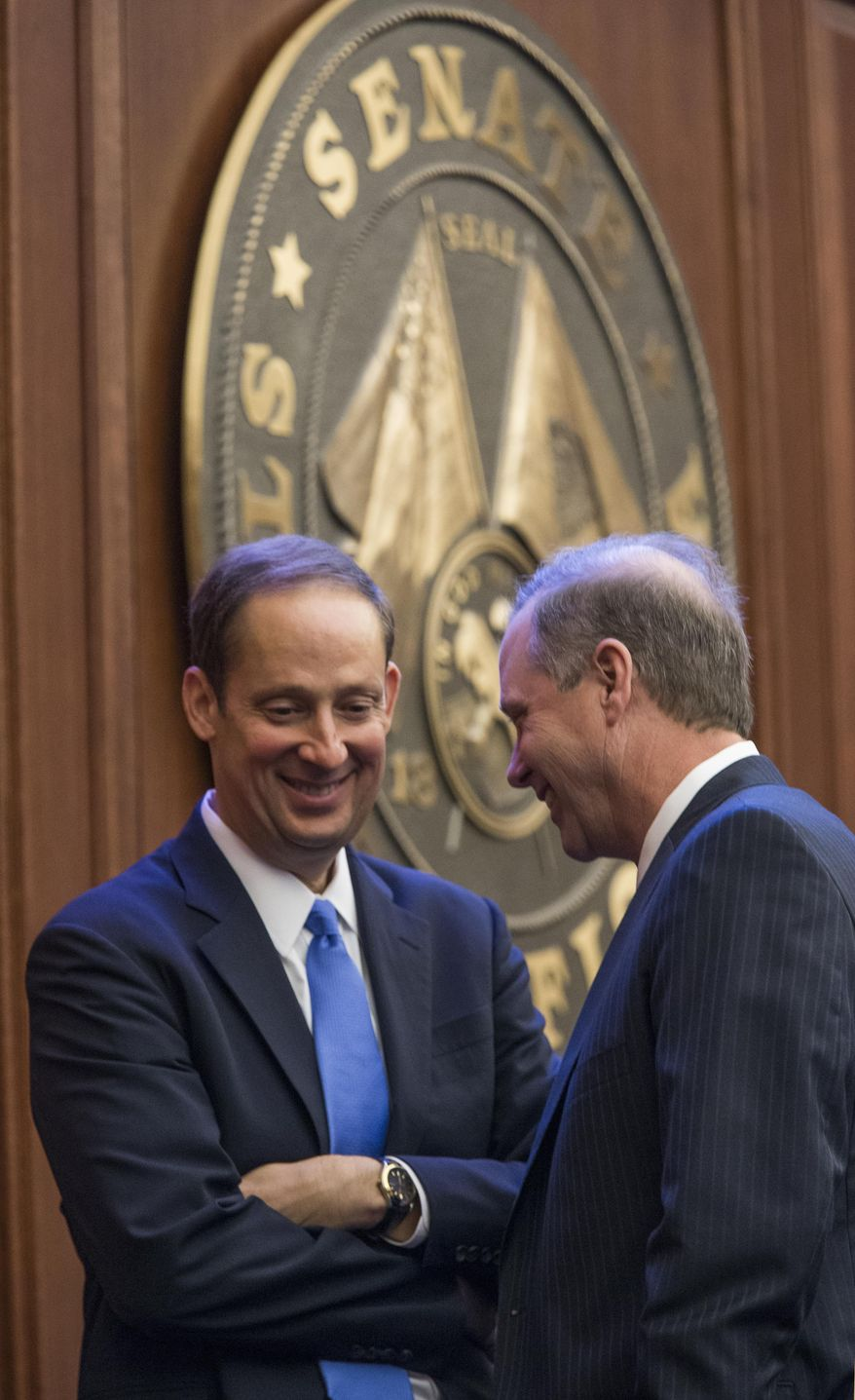 Senate President Joe Negron, left, and Sen. Wilton Simpson, R-Spring Hill, talks at the president's rostrum during the final hours of the legislative session Monday, May 8, 2017, at the Florida Capitol in Tallahassee, Fla. (AP Photo/Mark Wallheiser)