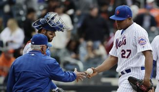 New York Mets relief pitcher Jeurys Familia (27) hands the ball to manager Terry Collins, left, as catcher Kevin Plawecki looks as Familia leaves in the ninth inning of a baseball game against the San Francisco Giants, Wednesday, May 10, 2017, in New York. (AP Photo/Frank Franklin II)