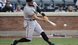San Francisco Giants' Hunter Pence hits an RBI single during the ninth inning of a baseball game against the New York Mets Wednesday, May 10, 2017, in New York. (AP Photo/Frank Franklin II)