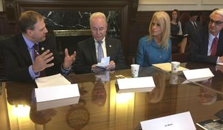 New Hampshire Gov. Chris Sununu, from left, U.S. Secretary of Health and Human Services Tom Price, second from left, Kellyanne Conway, an advisor to President Donald Trump, and Jeff Meyers, commissioner of New Hampshire's Department of Health and Human Services, take their seats on Wednesday, May 10, 2017, in the executive council chamber in Concord, N.H., prior to a closed-door meeting to gather information on the state's opioid crisis. (AP Photo/Kathleen Ronayne)