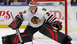 FILE - In this Feb. 19, 2017, file photo, Chicago Blackhawks goalie Scott Darling guards the goal during the first period of an NHL hockey game against the Buffalo Sabres in Buffalo, N.Y. Darling is ready to be a starting goalie for the first time. The Chicago Blackhawks' longtime backup is taking over as Carolina's top option following his recent trade to the Hurricanes. (AP Photo/Jeffrey T. Barnes, File)
