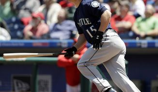 Seattle Mariners' Kyle Seager follows through after hitting an RBI-sacrifice fly off Philadelphia Phillies starting pitcher Zach Eflin during the first inning of a baseball game, Wednesday, May 10, 2017, in Philadelphia. (AP Photo/Matt Slocum)