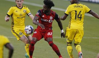 Toronto FC's Tosaint Ricketts, center, tries to dribble the ball between Columbus Crew's Zack Steffen, left, and Waylon Francis during the first half of an MLS soccer match Wednesday, May 10, 2017, in Columbus, Ohio. (AP Photo/Jay LaPrete)