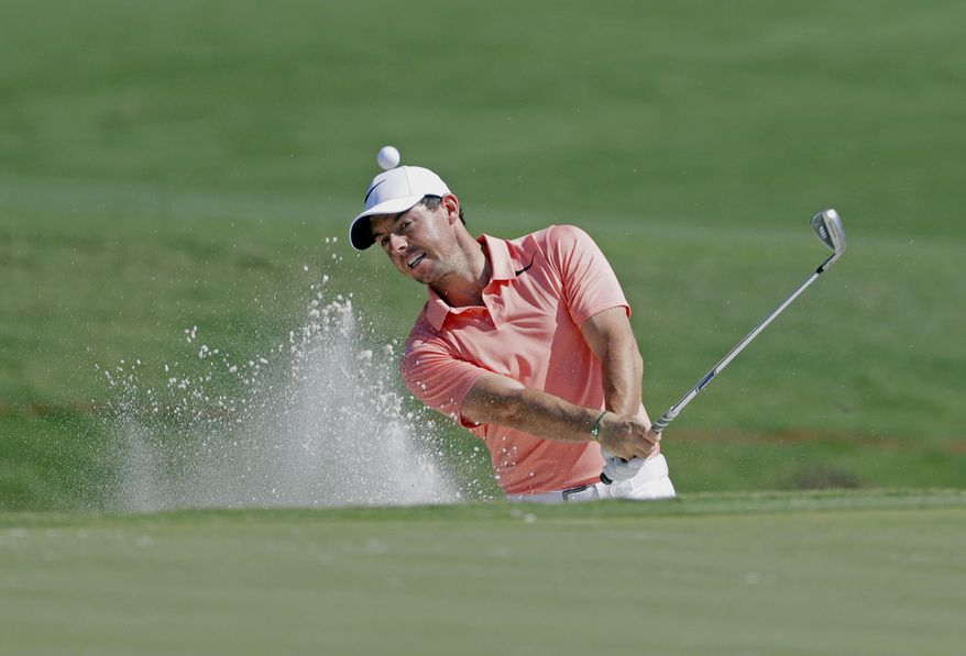 Rory McIlroy, of Northern Ireland, hits from a sand trap on the 11th hole, during a practice round for The Players Championship golf tournament Wednesday, May 10, 2017, in Ponte Vedra Beach, Fla. (AP Photo/Chris O'Meara)