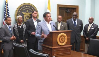 """FILE - In this Tuesday, April 11, 2017, file photo, Columbus, Ohio, Mayor Andrew Ginther, front center, joined by city officials, expresses his concern during a news conference in Columbus, Ohio, over a police officer captured on video that appears to kick a handcuffed suspect in the head. The officer used """"unreasonable"""" force that wasn't part of his training when subduing the restrained suspect police said Wednesday, May 10, 2017. (AP Photo/Andrew Welsh-Huggins, File)"""