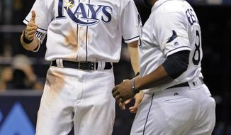 Tampa Bay Rays' Rickie Weeks Jr. (8) and Colby Rasmus, left, celebrate Rasmus' grand slam off Kansas City Royals reliever Peter Moylan during the eighth inning of a baseball game Wednesday, May 10, 2017, in St. Petersburg, Fla. (AP Photo/Steve Nesius)