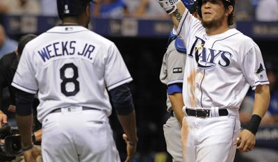 Tampa Bay Rays' Rickie Weeks Jr. (8) and Colby Rasmus, right, celebrate Rasmus' grand slam off Kansas City Royals reliever Peter Moylan during the eighth inning of a baseball game Wednesday, May 10, 2017, in St. Petersburg, Fla. (AP Photo/Steve Nesius)