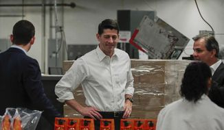 House Speaker Paul Ryan, center, tours a packaging facility in West Albany, Ohio, Wednesday, May 10, 2017. Ryan also plans to hold a roundtable discussion on tax reform with local business leaders. (AP Photo/Dake Kang)