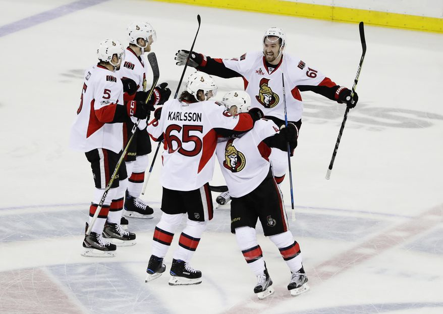 Ottawa Senators' Mark Stone (61) and Erik Karlsson (65) celebrate with teammates during the third period of Game 6 of an NHL hockey Stanley Cup second-round playoff series, Tuesday, May 9, 2017, in New York. The Senators won 4-2. (AP Photo/Frank Franklin II)