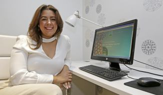 In this Tuesday, May 9, 2017, photo, small business owner Cristina Hermida poses for a photo, in Miami. Hermida, who owns two companies, Inside Crowd and Green Hopping, has interns who work for her remotely. (AP Photo/Alan Diaz)