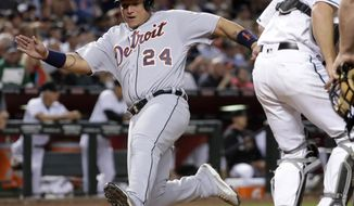 Detroit Tigers Miguel Cabrera (24) scores on a base hit by Mikie Mahtook during the fifth inning of a baseball game against the Arizona Diamondbacks, Tuesday, May 9, 2017, in Phoenix. (AP Photo/Matt York)