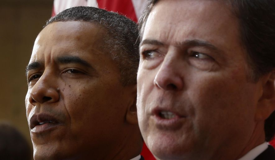 In this Oct. 28, 2013, file photo, President Barack Obama and FBI Director James Comey participate in the installation ceremony for Comey as FBI director, at FBI Headquarters in Washington. President Donald Trump abruptly fired Comey on May 9, 2017, dramatically ousting the nation's top law enforcement official in the midst of an FBI investigation into whether Trump's campaign had ties to Russia's election meddling. (AP Photo/Charles Dharapak, File)