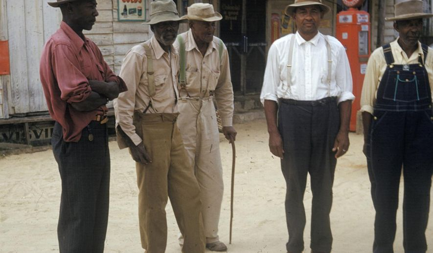 In this 1950's photo released by the National Archives, men included in a syphilis study pose for a photo in Tuskegee, Ala. For 40 years starting in 1932, medical workers in the segregated South withheld treatment for unsuspecting men infected with a sexually transmitted disease simply so doctors could track the ravages of the horrid illness and dissect their bodies afterward. It was finally exposed in 1972. (National Archives via AP)