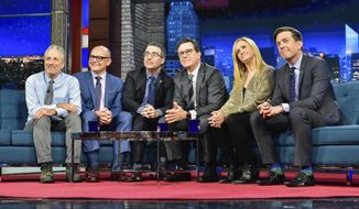 """In this photo provided by CBS, host Stephen Colbert, third from right, sits with guests, from left, Jon Stewart, Rob Corddry, John Oliver, Samantha Bee, and Ed Helms during """"The Late Show with Stephen Colbert,"""" on Tuesday, May 9, 2017, in New York. It was a rare TV reunion Tuesday as Colbert played host to a gang of his fellow """"Daily Show"""" alums on a special edition of CBS' """"The Late Show."""" (Scott Kowalchyk/CBS via AP)"""