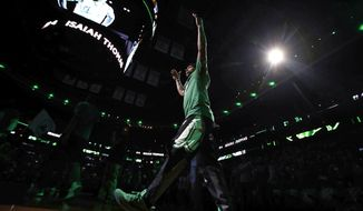 Boston Celtics guard Isaiah Thomas raises his arms as he is introduced before Game 5 of a second-round NBA basketball playoff series against the Washington Wizards in Boston, Wednesday, May 10, 2017. (AP Photo/Charles Krupa)