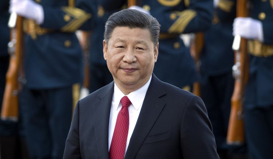 In this May 11, 2017, photo, Chinese President Xi Jinping walks during a welcome ceremony for Vietnam's President Tran Dai Quang at the Great Hall of the People in Beijing. China will seek to burnish President Xi Jinpings stature as a world-class statesman at an international gathering centered on his signature foreign policy effort envisioning a future world order in which all roads lead to Beijing. The Belt and Road Forum opening Sunday, May 14, is the latest in a series of high-profile appearances aimed at projecting Xis influence on the global stage ahead of a key congress of the ruling Communist Party later this year. (AP Photo/Mark Schiefelbein)
