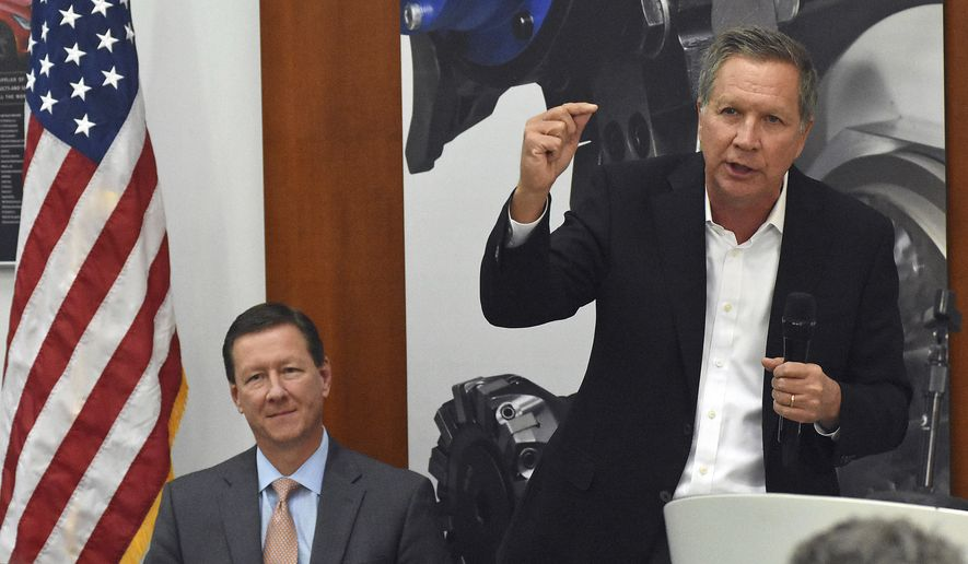 Ohio Gov. John Kasich, right, addresses GROB employees and media while at GROB Systems Inc. in Bluffton, Ohio on Thursday, May 11, 2017. Kasich visited GROB to discuss state budget reforms to strengthen Ohio's workforce. Seated to the left is, Michael Hutecker, CEO at Grob Systems, Inc. (Craig J. Orosz/The Lima News via AP)