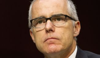 Acting FBI Director Andrew McCabe listens on Capitol Hill in Washington, Thursday, May 11, 2017, while testifying before the Senate Intelligence Committee hearing on worldwide threats. (AP Photo/Jacquelyn Martin)