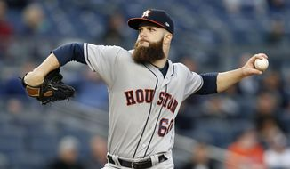 Houston Astros starting pitcher Dallas Keuchel delivers during the second inning of the team's baseball game against the New York Yankees in New York, Thursday, May 11, 2017. (AP Photo/Kathy Willens)