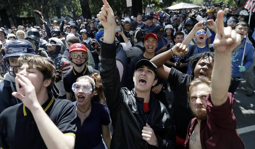 Demonstrators held a rally for free speech near the University of California, Berkeley, in April after a speech by conservative author Ann Coulter was canceled amid threats of violence, just one example of a speaker with controversial views being blocked from talking. (Associated Press/File)