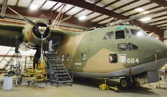 In this April 15, 2017 photo, a C-123 Provider aircraft that is still operational is restored and maintained in the hanger at Beaver County Airport in Beaver Falls, Pa. While this specific plane never left the country, it is painted in colors authentic to those used on planes that served in Vietnam. (Mark Marietta/Observer-Reporter via AP)