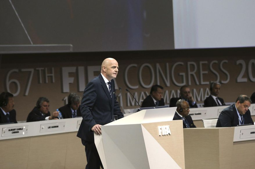 """FIFA President Gianni Infantino, left, speaks during the FIFA Congress, in Manama, Bahrain, Thursday, May 11 2017. Addressing his second congress of soccer nations as FIFA president, Infantino lambasted """"fake news"""" following criticism of his leadership. Infantino didn't cite any reports but it comes in the week ethics judge Hans-Joachim Eckert and FIFA prosecutor Cornel Borbely denounced the decision to remove them from their posts. (AP Photo)"""