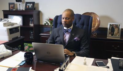 File- In this Monday, Feb 6, 2017, file photo, Senate Majority Leader Aaron Ford D-Las Vegas settles into his new office on opening day of the Legislative Session. at the State Capital in Carson City, Nev. Following the defeat of a federal internet privacy rule, Nevada's Senate leader is pushing to mandate websites disclose what types of personal information they collect from Nevadans. Ford on Thursday, May 11, 2017, introduced emergency legislation that would require all commercial websites, like Facebook, and internet connection providers, such as Comcast, to notify consumers of categories of identifying information they amass. (AP Photo/Lance Iversen, File)