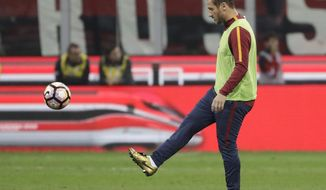 Roma's Francesco Totti warms up at half time during an Italian Serie A soccer match between AC Milan and Roma, at the San Siro stadium in Milan, Italy, Sunday, May 7, 2017. (AP Photo/Luca Bruno)